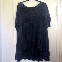Free People Acid Wash Tee An essential for anyone's wardrobe. A perfect basic with a bit of extra flare. This charcoal colored acid wash shirt from Free People is new without tags. Short sleeved with a slight high low cut at bottom. Very oversized and could for sizes X-small through 2XL. Exposed seams at back. Made of the softest most comfortable material ever! Free People Tops Tees - Short Sleeve