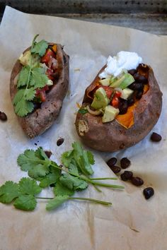 Mexican way stuffed sweet potato with black beans, avocado, cilantro and sour cream - The Recipe Suitcase