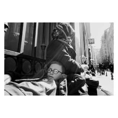 Street photographer sneaky photographed young boy resting.
