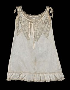 Ca. 1900 chemise of sheer white cotton, yoke and shoulder straps of machine made lace