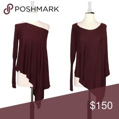 ✨ SALE Asymmetrical Burgundy Off Shoulder Sweater This gorgeous tunic by Romeo & Juliet Couture is asymmetrical, which gives it a unique style and has the option of wearing it off the shoulder on one side or over the shoulder, poncho style on that side. This top is perfect for a date night. Pair it with jeans for a casual look or dress it up with layers.  ❌ Sorry, no trades.   vneck v-neck  200244 Anthropologie Tops Tunics