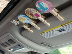 Road trip clips: One clip for each kid.... If they are sweet, clip stays up, if they are not, clip comes down. Everyone with a clip on the visor gets a treat at the next stop :-)