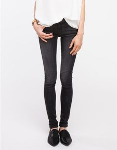 Mid-rise stick skinny stretch denim with classic 5-pocket styling, a single-button and zip closure, and fading throughout for a casual worn-in look.  73% Cotton, 14% Rayon, 11% Polyester, 2% Spandex Made in USA