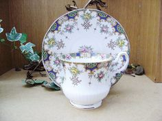 Hey, I found this really awesome Etsy listing at https://www.etsy.com/listing/126915707/vintage-teacup-and-saucer-queens-rosina