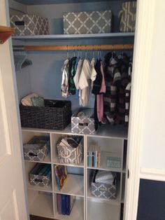 Nursery closet organization. Painted the inside blue. 2 storage cubes from target. And all the cute little baskets are from Marshall's.