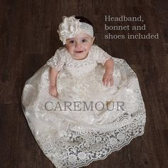 • Lace Christening gown • Cotton Lining • Headband, Shoes and Bonnet included • Handmade. Heirloom quality • Cap Sleeves • Button loop closures at the back • Hand sewn rhinestones on dress • Rhinestone belt on waist • Ships worldwide in 3-5 business days! Sizing ( dress measurements)