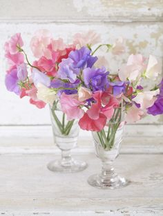 Sweet Peas in Old Fashioned Wine Glasses. Love the simplicity of sweet peas and the smell.