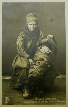 Saami Mother and Child, Norway    Photograph of an old postcard from my own collection.    Old postcard circa 1920 showing a Saami / Lapp woman with her young child.