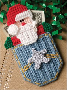 """Pocket Santa Ornament Plastic Canvas (Imagine changing the front motif, and putting another motif where Santa is, and you could use this all year 'round. I like the original design a lot, and would make it this way, too -- though I might swap out the star for a candy cane, or """"Christmas the pocket pattern a bit in color and pattern.)"""
