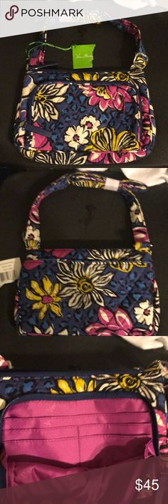 NWT Vera Bradley crossbody bag w/ wallet pouch NWT Vera Bradley Little Hipster in African Violet. This is another brand new Vera crossbody bag that's smaller in size but wallet pouch (see pic #2) makes up for it in function! Includes one outside zippered pocket (with card slots doubling as wallet) and one outside slip pocket.  Inside you will find one zippered pocket with tag attached. The print is beautiful with dark blue, pink, yellow, and white. Strap is fully adjustable making this…