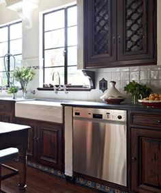 by Lili O'Brien & Leigh Anne Muse Interior Design - Spanish Colonial Revival. Wood kitchen.