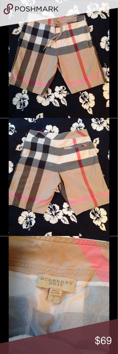 Burberry Brit Mens Swim Trunks. S Classic check. Slit pockets at hip. Back pocket. Mesh lining. Velcro closure with tie. Cotton/nylon. A little faded. S. burberry Swim Swim Trunks