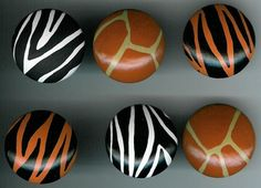 Bring out the wild side in you! The perfect way to add some accent designs to a drab cabinet, dull room or to create your own jungle decor. A set of 6 cabinet pull knobs that will bring out the dangerous side in you! Two zebras, two tigers and two giraffe animal print designs. EACH cabinet knob is hand painted by me, myself and I. Each set of knobs is made when ordered. A set of 6 can be completed and ready to ship usually within 7 to 10 days. If you have any changes you want made or a…