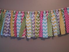 Rag Tie Garland- classroom decor, can use this in bookshelves to cover books.only I would do them in black, white and red for my classroom theme. Chevron Classroom, Classroom Setup, Classroom Design, Kindergarten Classroom, Future Classroom, School Classroom, Class Decoration, School Decorations, Classroom Supplies