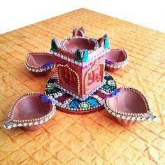 Diya Plate & Tulsi with 4 diya - Online Shopping for Diyas and Lights by Dipti Art & Craft Diwali Decoration Items, Thali Decoration Ideas, Diwali Decorations At Home, Festival Decorations, Diwali Diya, Diwali Craft, Diwali Gifts, Diy Home Crafts, Clay Crafts