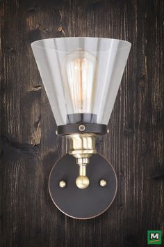 Patriot Lighting® Bevin Wall Light features an Oil-Rubbed Bronze and Antique Brass Finish with Clear Glass
