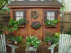 Flowers make this garden shed much nicer to look at.