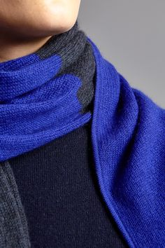 The Duette Shawl in Indigo Ultramarine.  The DUETTE features a 'half and half' hued knit. The supremely soft cashmere of Mongolia has protected nomads of the steppe for centuries. This piece was crafted using cashmere from those very same lands. The vibrant colours of this piece are achieved by using Swiss dyes on the cashmere fibre itself. This process results in a far richer finish than the more common method of dying only the finished item.