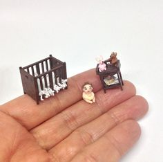 I am a handmade 48th scale dollhouse baby and can be found at IckleFingz on Etsy :0)