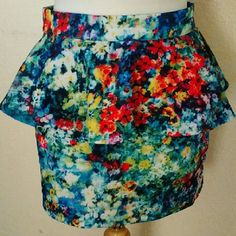 """Peplum Color Splash Skirt Array of fabulous colors an style make this skirt one everybody wants!  Size Medium. Has a bit of stretch to it. Length is 15"""".  Has been worn once.  Fab condition.  Zips up the back.Thanks! LAtiste Skirts A-Line or Full"""