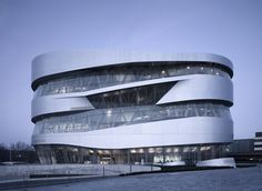 Ten kilometer south from the Porsche Museum we featured last week, we find the Mercedes Benz Museum, designed by dutch architects UN Studio and photographed