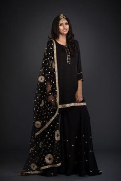 This buttery soft sharara set in a magical fabric called cotton satin with zari and gota detail is an outfit you cannot go wrong with! Ideal for sangeet and coc Pakistani Dress Design, Pakistani Outfits, Indian Outfits, Pakistani Clothing, Indian Clothes, All Black Dresses, Heavy Dresses, Beautiful Suit, Beautiful Outfits