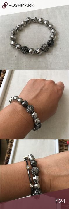 Stella & Dot silver stretch bracelet Brand new Stella & Dot silver stretch bracelet. Silver beads wrap the bracelet with black and sparkle beads for added interest. Shown with other bracelets for fun arm party ideas. Other bracelets listed as well. Bundle for additional saving! Stella & Dot Jewelry Bracelets