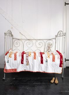 Cassandra Ellis quilt in Mollie Makes magazine // white and red quilt on white iron children's bed // painted black floors and white walls