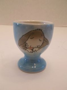 Sleepy Bunny Rabbit Egg Cup - well this is just adorable.  I can't make fun of it.  Darn.