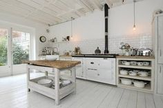 This is apparently Sophie Dahl's kitchen obviously before the set designers added colour. Loving the white too