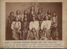 Northern Cheyenne group - 1879 Standing L-R: one of Crow's daughters, Old Man, Left Hand, unknown, Blacksmith, Frizzle Head, one of Crow's daughters Sitting in chairs L-R: Porcupine, Crow's wife, Crow, Wild Hog Sitting on floor L-R: Wild Hog's son, Wild Hog's daughter