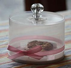 Re-purpose an old CD spindle to make a pretty small cake/biscuit holder.