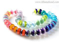 Infinite Horizons A Colorful Strand of Glass Beads by lilianabead