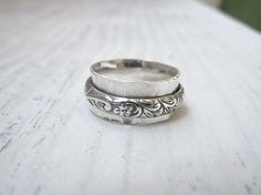 Hey, I found this really awesome Etsy listing at https://www.etsy.com/listing/159317751/sterling-silver-spinner-ring-carved