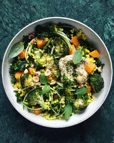 Golden sorghum salad with roasted broccoli, butternut squash, herb hummus and hazelnuts