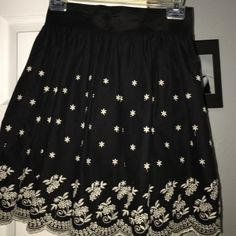 Black Embroidered Skirt This youth/petite sized Rhapsody skirt is new with original tags. It has an embroidered floral design on the bottom and an elastic waist band for a comfortable fit. Machine washable. Skirts Mini