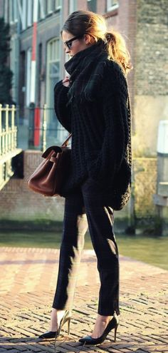 black skinnies, black pointy heels, black sweater, big bag, sunnies and pony tail.  Yes, this is my look