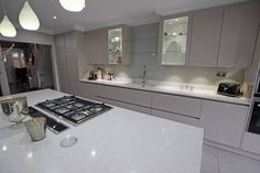 High gloss Cashmere kitchen with island