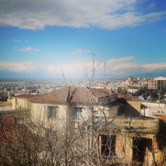The view from the north-western city wall towards the west suburbs is rewarding. Walking Thessaloniki app, Route 11 - Upper Town C (Download for FREE) #travel #guide #Greece #Citywall #Byzantine #sky #iPhone