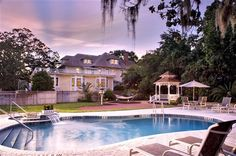 Huge pool & Spa with a waterfall at Hoyt House Bed & Breakfast Inn - Amelia Island, FL