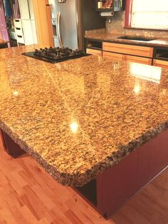 "Kitchen island ""after"" with 6cm Portofino granite with chiseled edge."