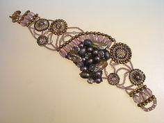 Nouveau Nirvana Bracelet by Jeka Lambert.  Seed bead woven.  Stick pearls, faceted freshwater pearls, faceted glass beads, pressed glass beads, seed beads.
