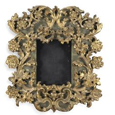 An Italian carved giltwood and green painted frame, Bolognese mid 17th century 60cm high., 56cm wide.; 1ft. 11 3/4 in., 1ft. 10 1/4 in.