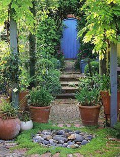 blue door in the garden, Garden Blues. Brabourne Farm