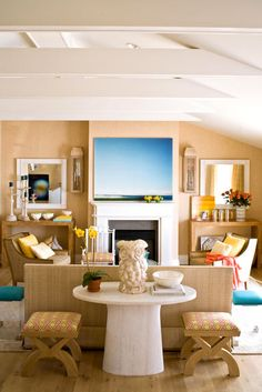 From afar, I thought the art above the fireplace was a TV.  It's camouflaged in a way because of the flanking mirrors.