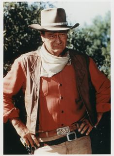 John Wayne, now if I wanted to impress someone that open carry advocates weren't nuts with their fingers on the trigger posing for a photo, this is how I would try to represent it.