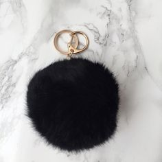 """Last One! Pom Pom Keychain Get in on one of the biggest fashion trends of the year, without breaking the bank! This black faux fur Pom Pom is so soft and hangs on a gold metal key ring and clip. Measures approx 4"""" circumference  c o n t e n t rabbit fur  c o l o r + black  m e a s u r e m e n t s + 4"""" circumference  h o s t  p i c k! 5/17/2016 • Summer Preview ☀️   p a i r  w i t h   Your favorite purse Your car keys Accessories"""