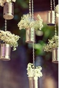 I really like baby's breath as an accent. It was Jeff's mother's favorite flower. Since she passed away about a year and a half ago, I would love to incorporate her in this way.  Inexpensive Tin Can flowers DIY...but i would wrap burlap around the cans!