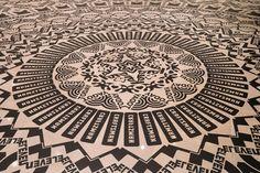 Wheel of Everyday Life by Gunilla Klingberg. Take a closer look - all familiar branding/logos make up this amazing floor installation.