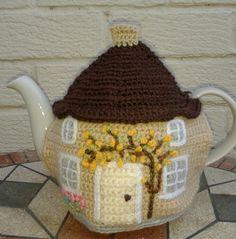 cream and brown crochet tea cosy